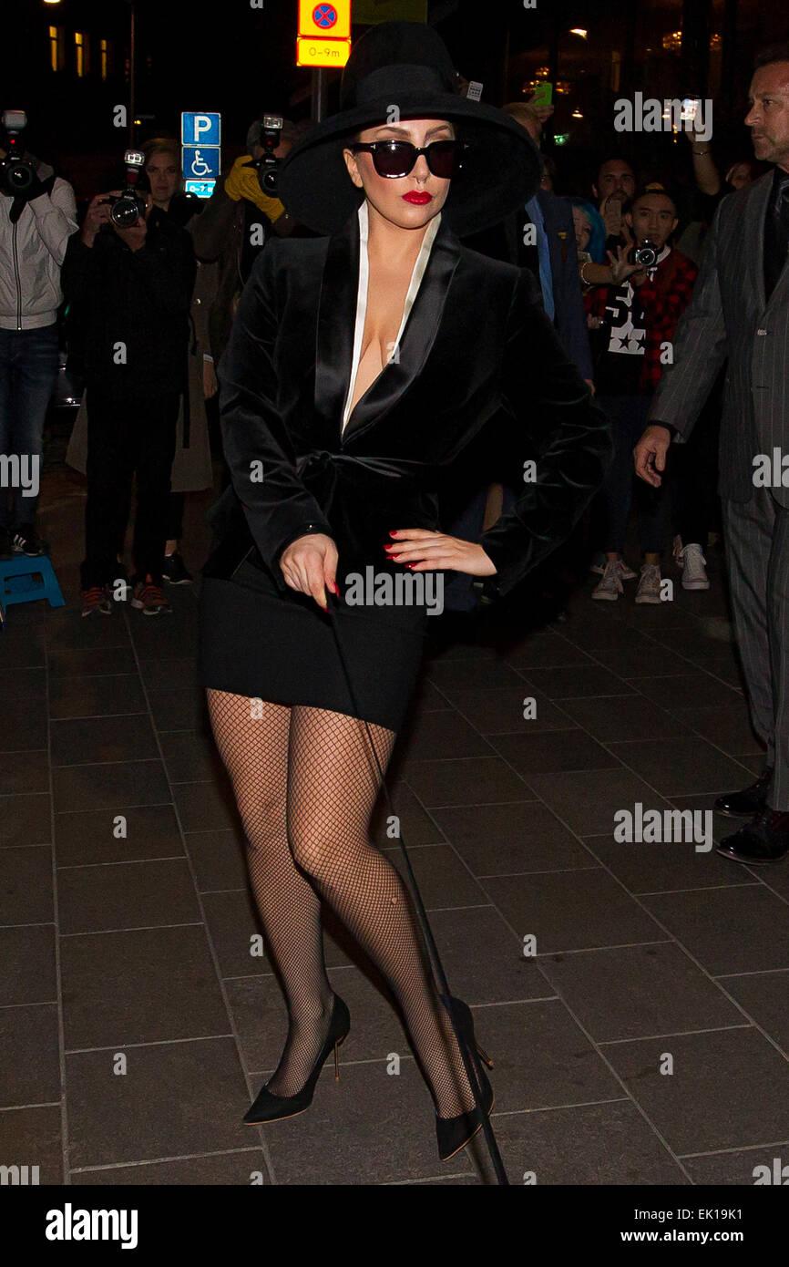 lady gaga leaving the grand hotel in high heels fishnet