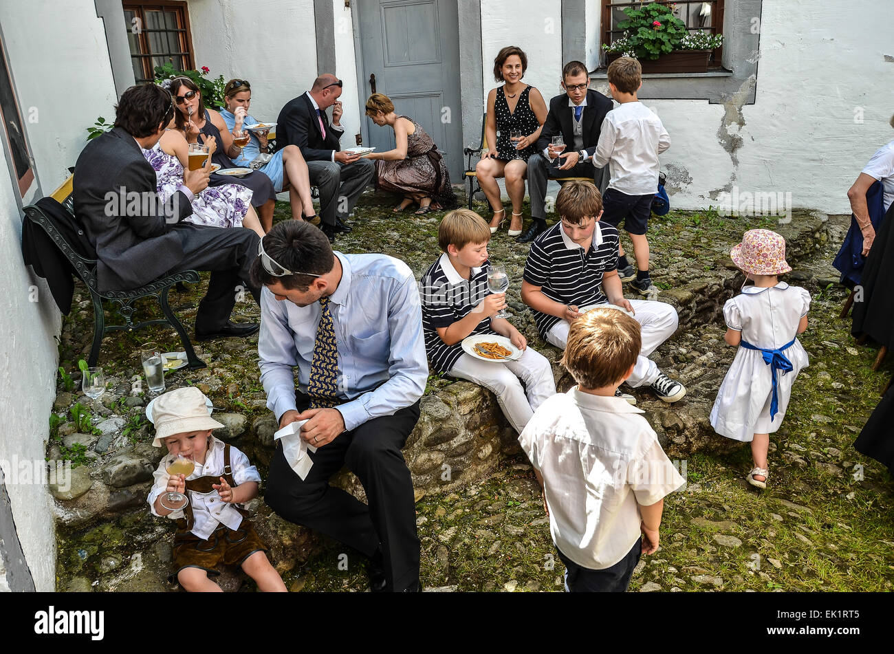 Wedding After Ceremony Party Outdoors Guests Dress Colourful Hats Eating Drinking Talking Families Children