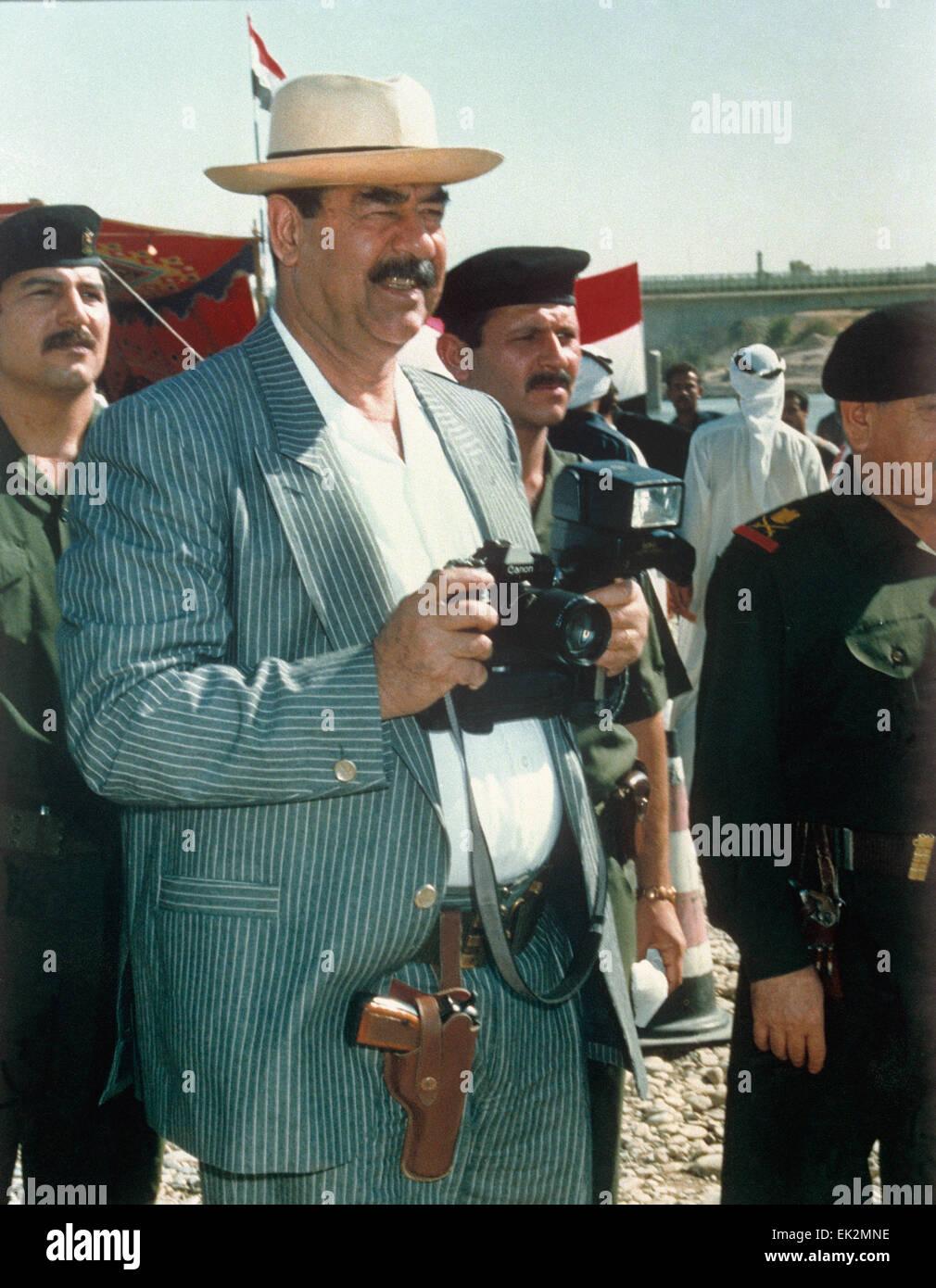 iraq iraqi president saddam hussein with camera