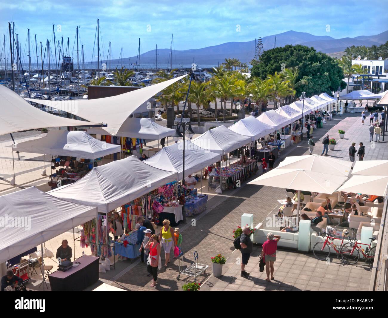 The weekly market at Puerto Calero Marina resort Lanzarote Canary Stock Photo...