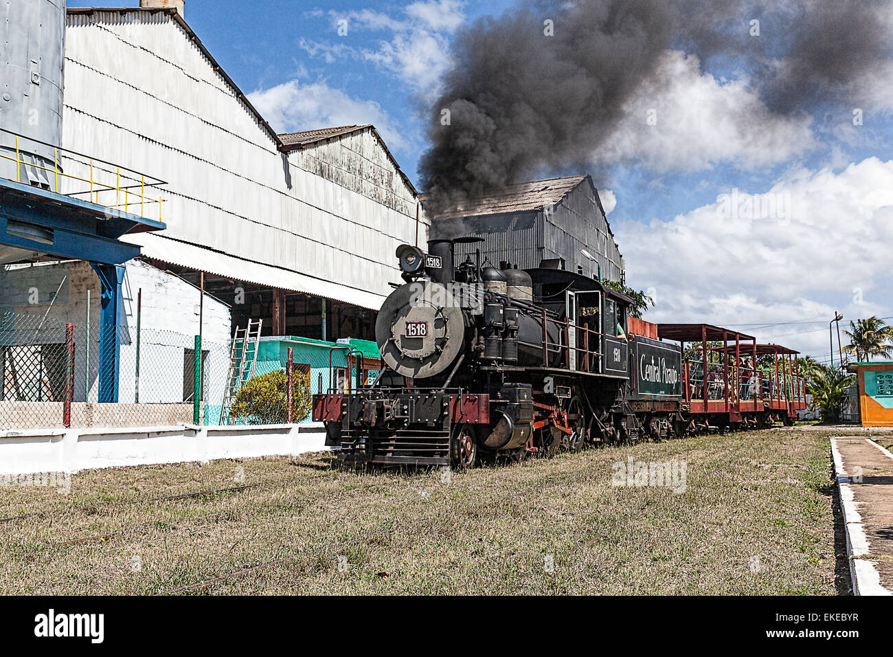 american steam engine  cuba  thick black smoke coming  stock photo royalty