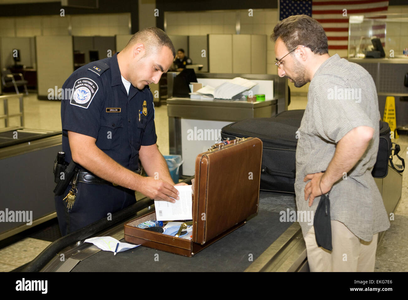customs officer airport stock photos customs officer airport cbp officer inspects a passengers lugggage at an airport james tourtellotte stock image