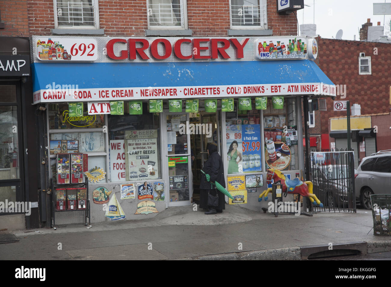 bodega grocery store along 4th avenue in brooklyn ny stock photo royalty free image 80884148. Black Bedroom Furniture Sets. Home Design Ideas