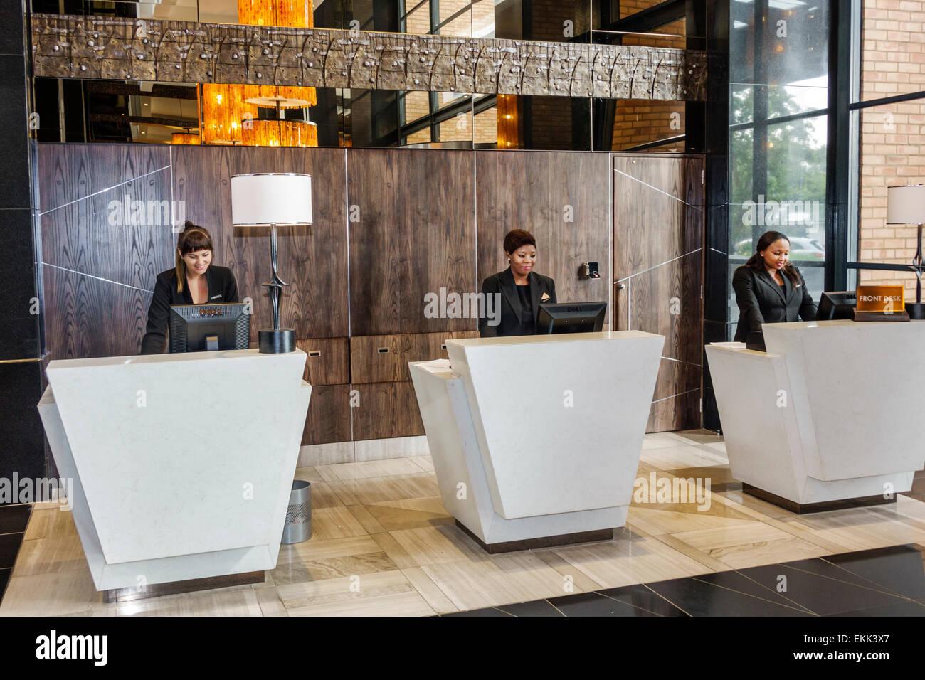 Johannesburg South Africa African Rosebank Hyatt Regency Hotel Lobby Front Desk Reservations Black Woman Employee Job Coworkers Working
