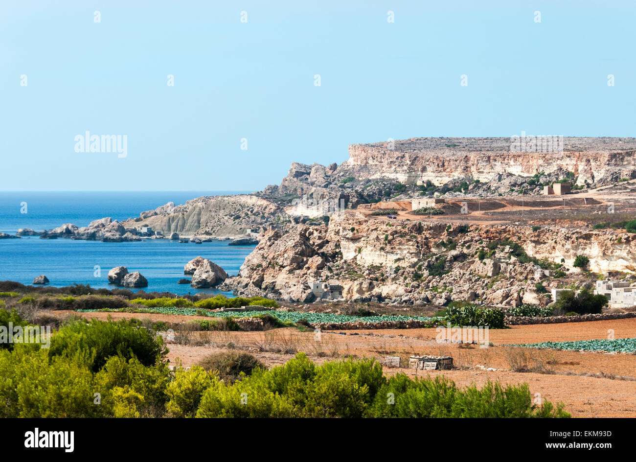 Rocks In Spanish Part - 46: Stock Photo - Blue Tropical Ocean And Big Rocks With Green Plants In  Foreground On The Spanish Island Malta