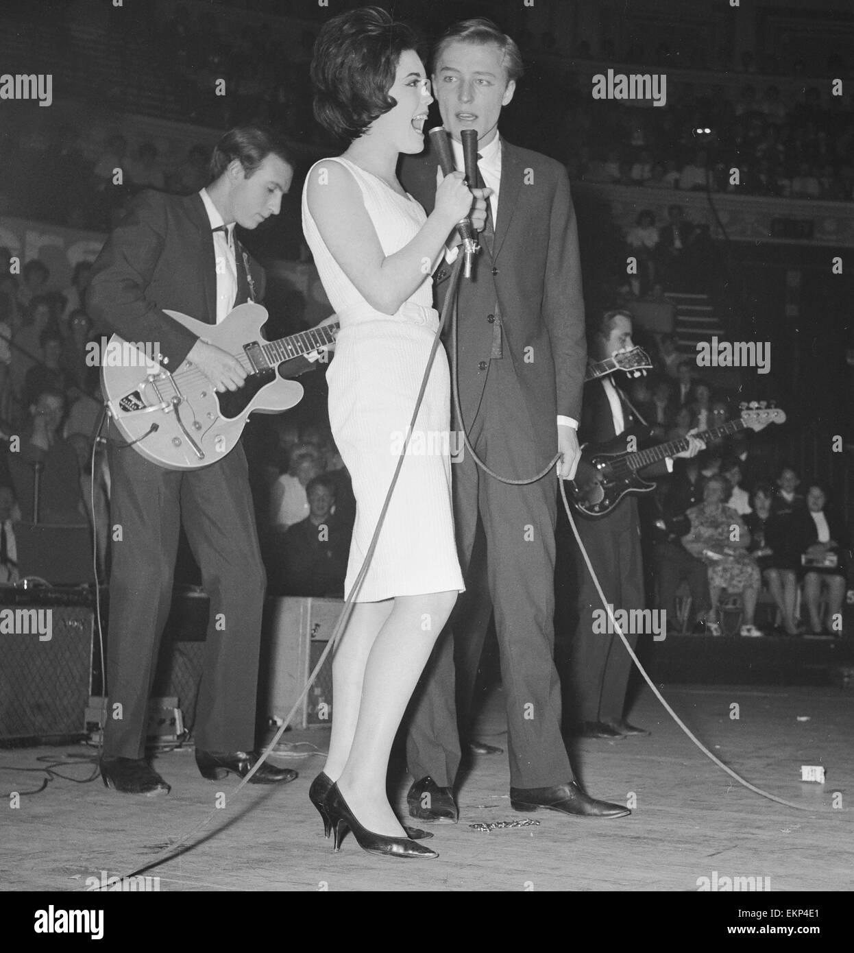 british pop singer mike sarne performing on stage at the pop prom british pop singer mike sarne performing on stage at the pop prom at the royal albert hall partner billie davis 16th 1962