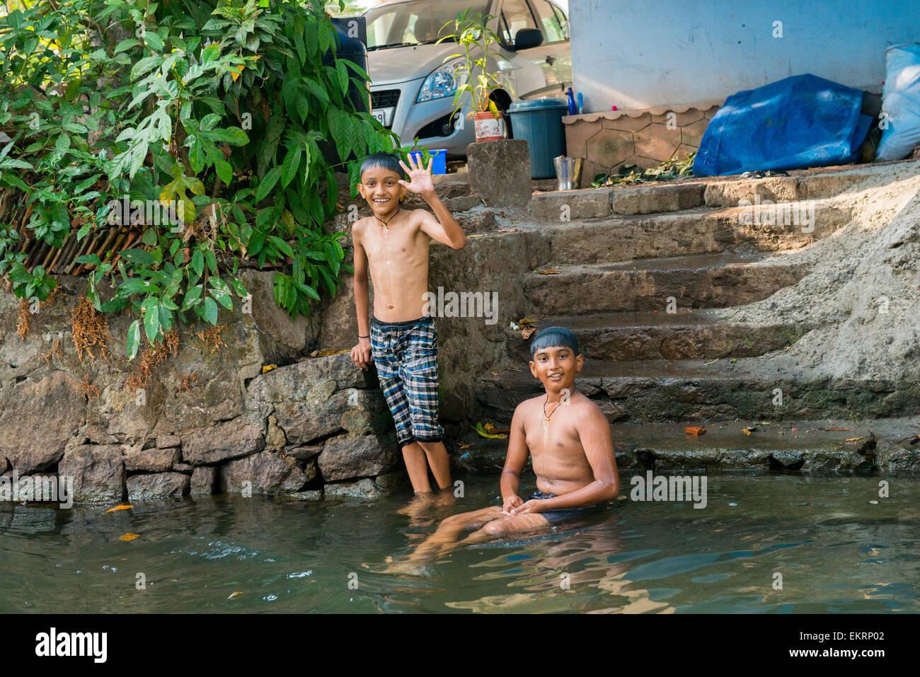 bald indians boys bathing river