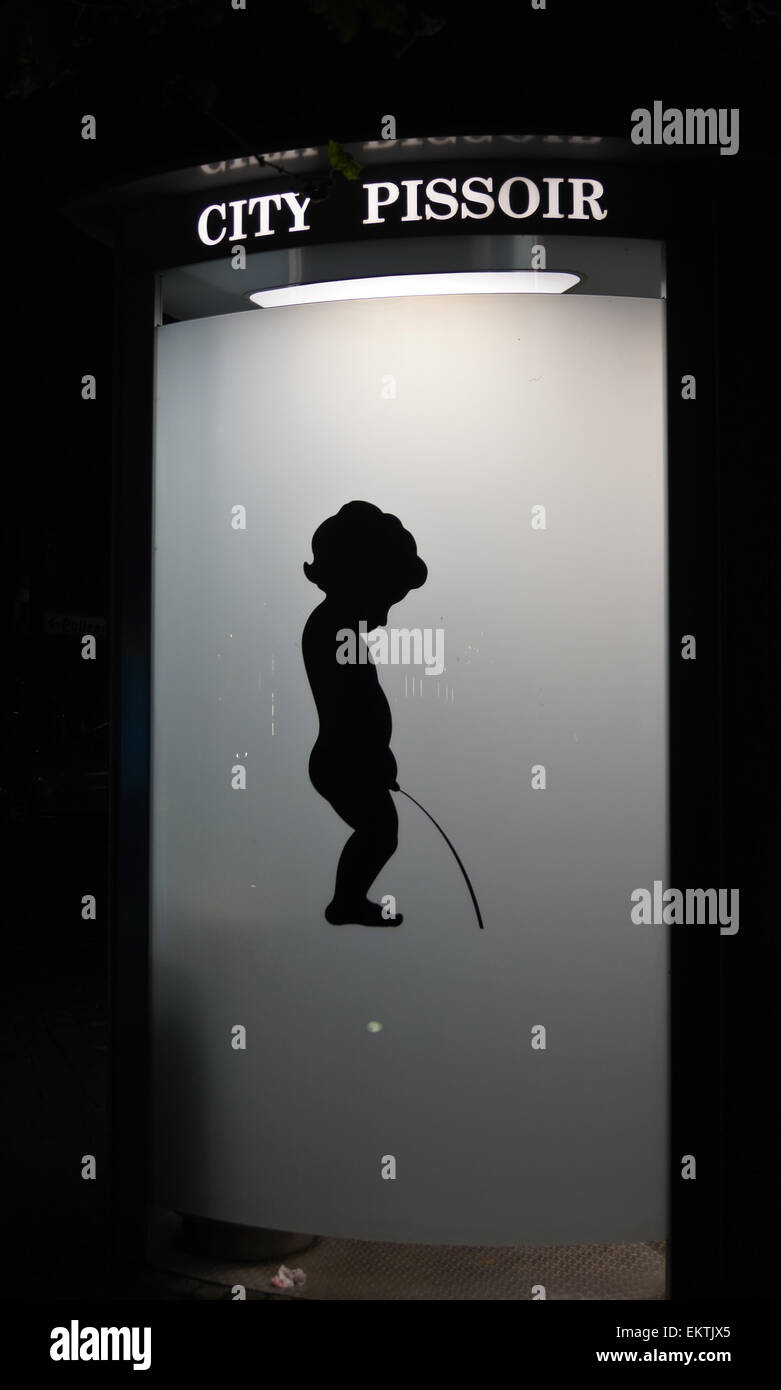 silhouette-of-a-boy-urinating-on-a-city-