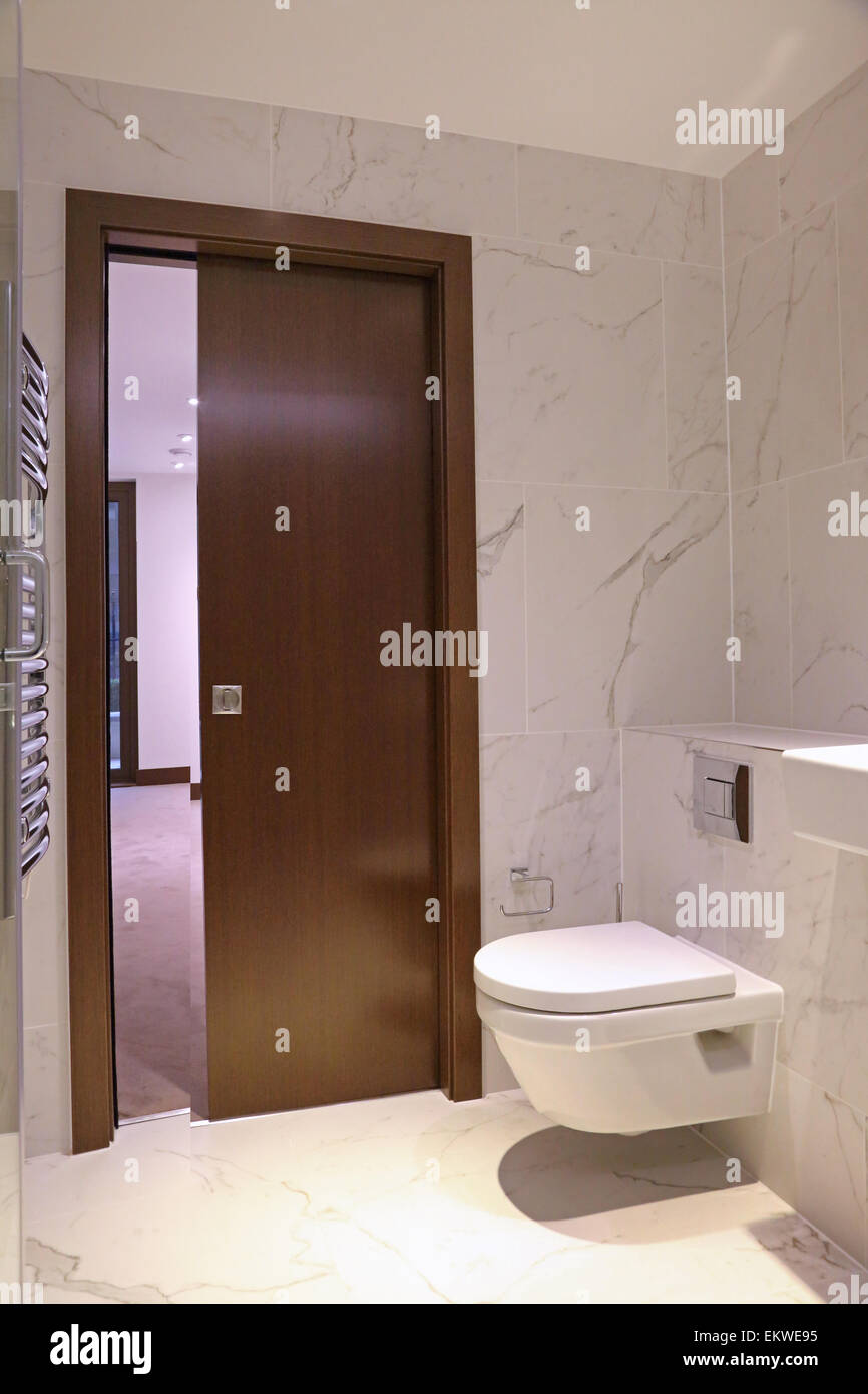 Toilet / Bathroom In A Newly Built Luxury Apartment With A Concealed  Sliding Door And A Wall Hung Toilet With Concealed Cistern
