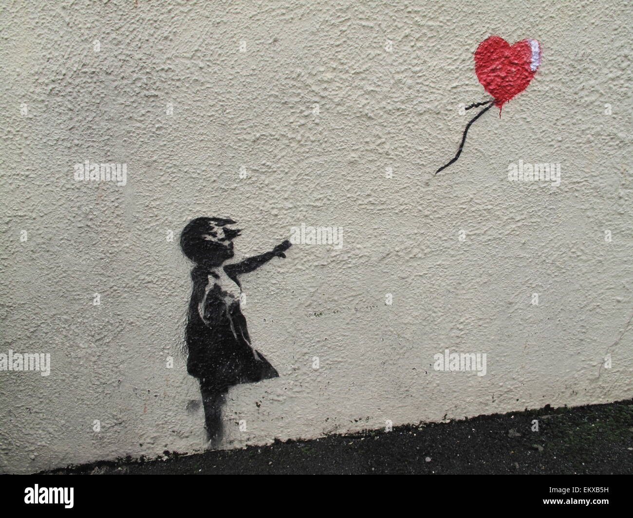 A Banksy mural of girl with red balloon on wall in Brixham ...
