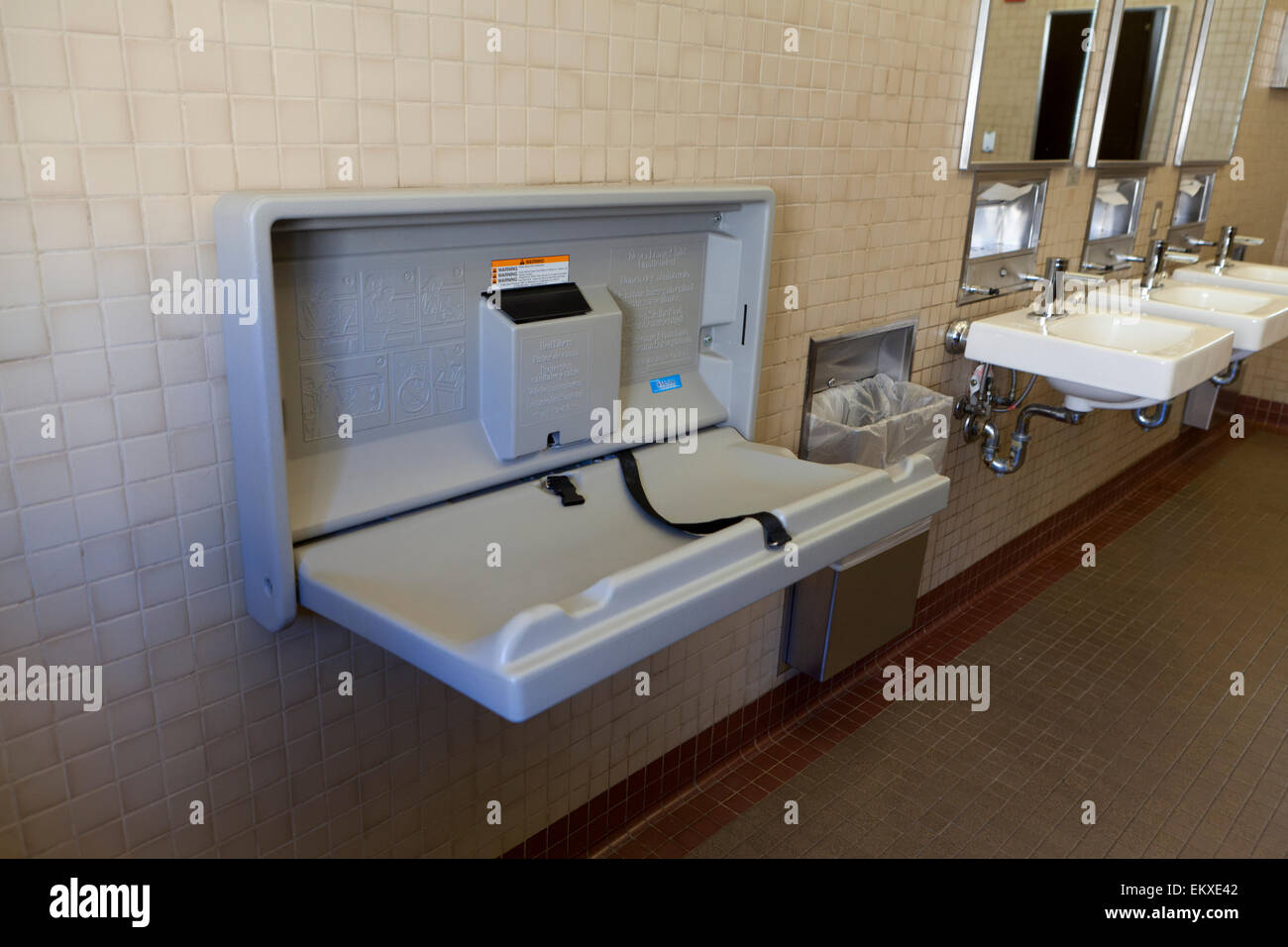 folding baby changing table in public restroom  usa stock photo  -  folding baby changing table in public restroom  usa  stock photo