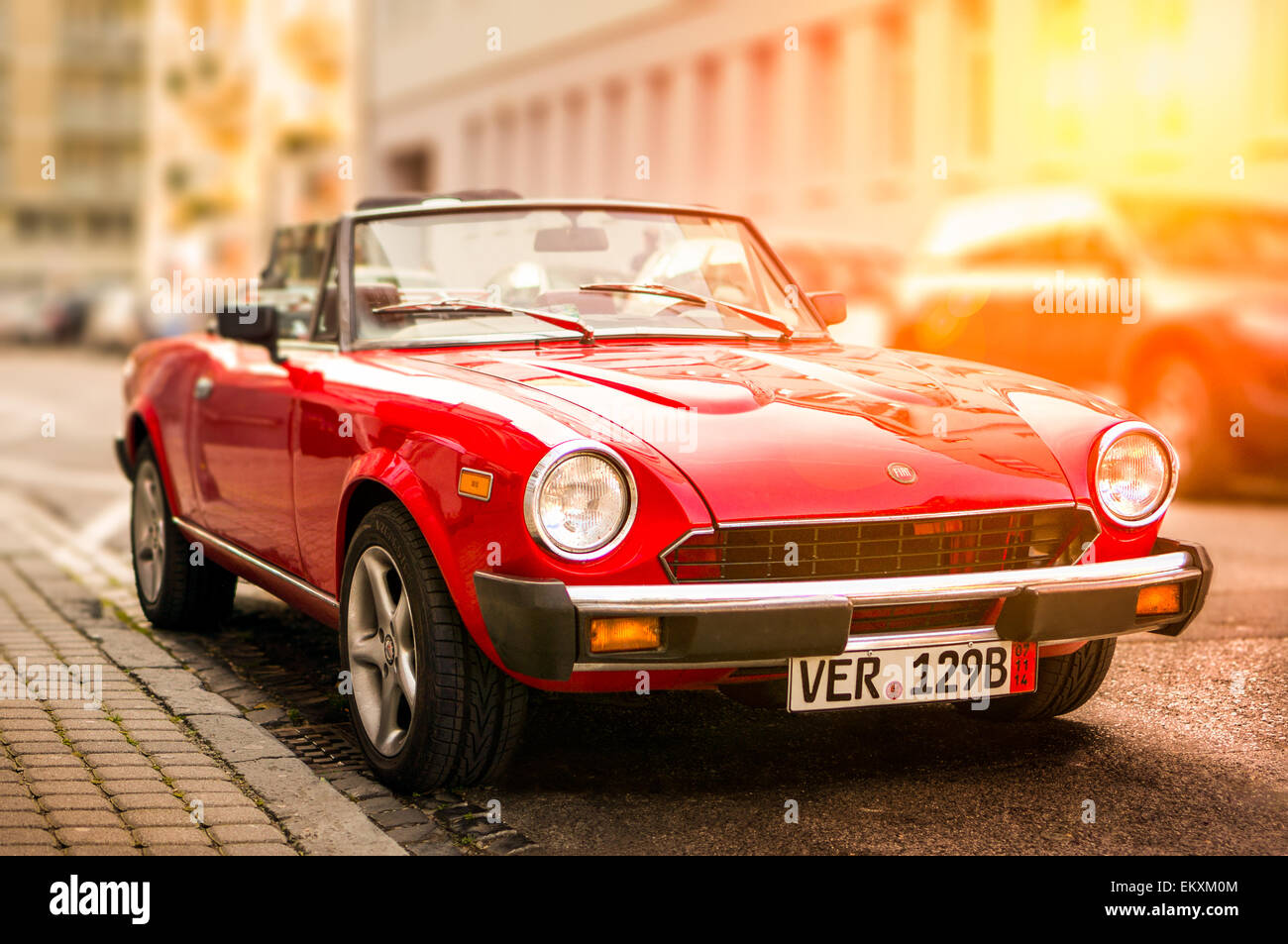 retro fiat sports car standing by the side of the street on a sunny stock photo royalty free. Black Bedroom Furniture Sets. Home Design Ideas