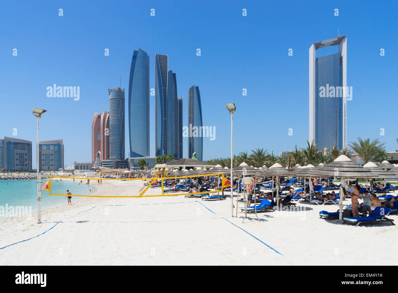 Skyline view of etihad towers from luxury hotel beach in abu dhabi in united arab emirates