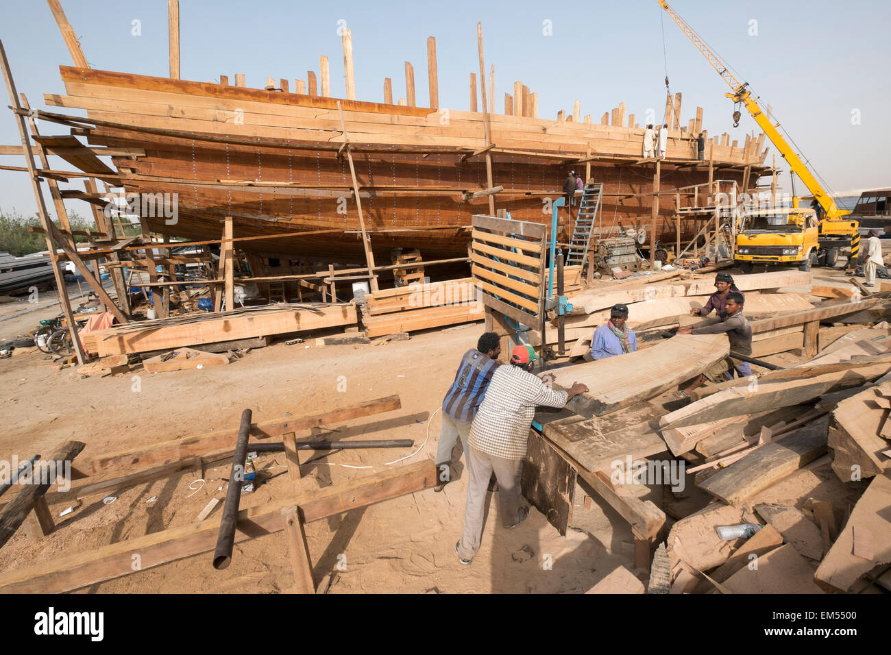 Building a traditional wooden dhow cargo ship in shipyard ...