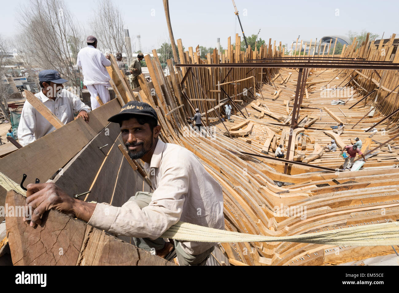 Craftsmen Building A Traditional Wooden Dhow Cargo Ship In ...