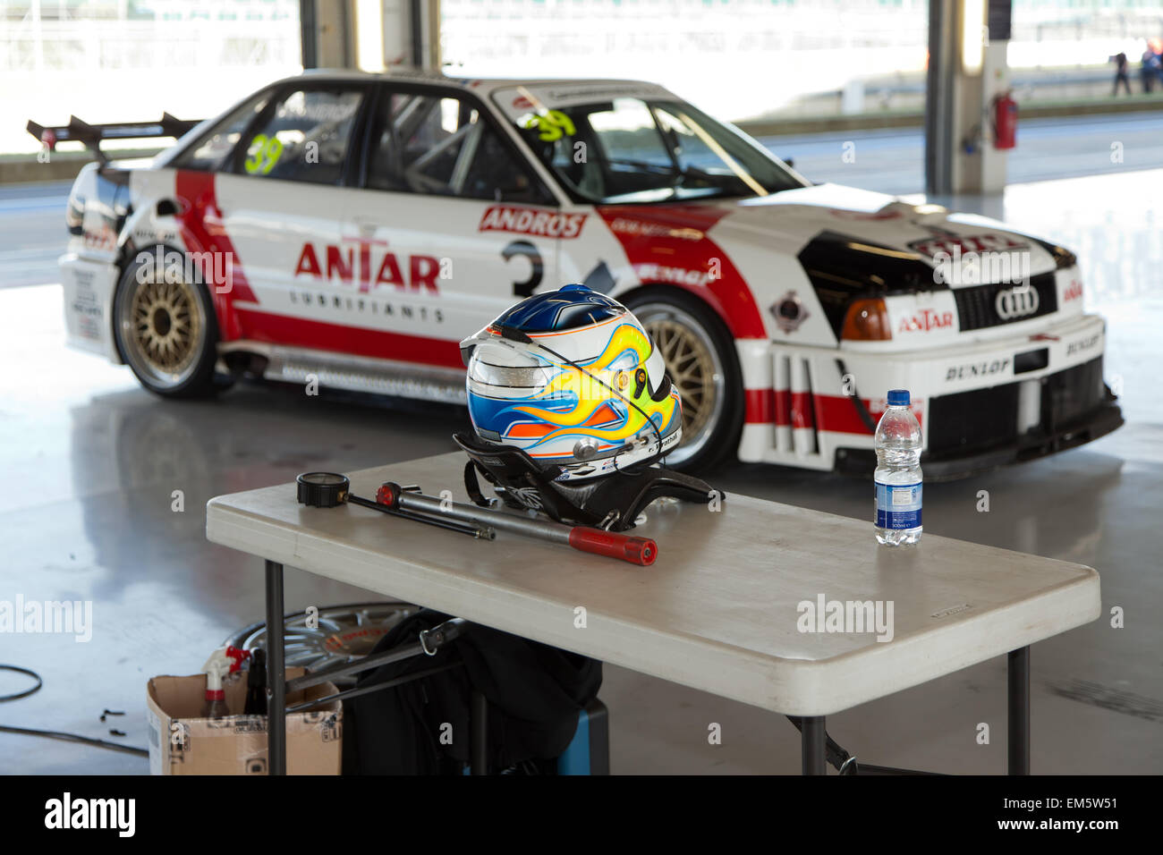 Drivers Helmet And HANS Device Infront Of An Audi Touring Car In - Audi car garage