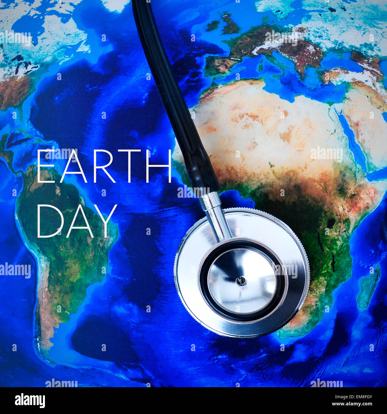 Closeup of a stethoscope on a world map furnished by nasa and the closeup of a stethoscope on a world map furnished by nasa and the text earth day gumiabroncs