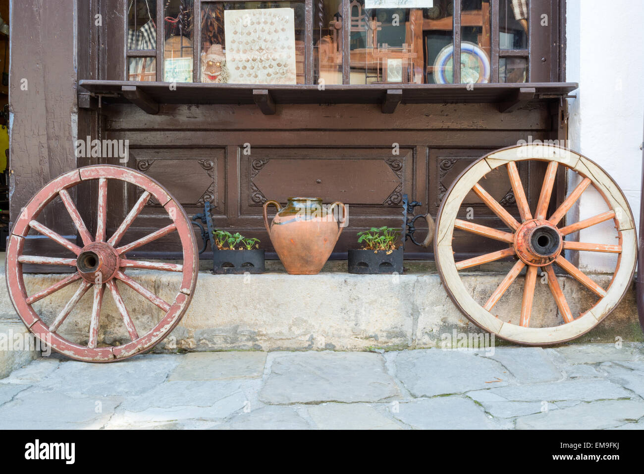 Two Old Wagon Wheels On A Street, Tryavna, Bulgaria