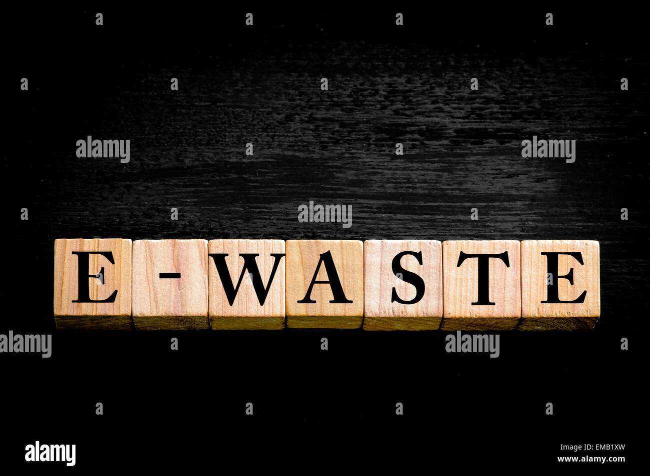 E waste background images - Stock Photo Word E Waste Standing For Electronic Waste Wooden Small Cubes With Letters Isolated On Black Background With Copy Space Available