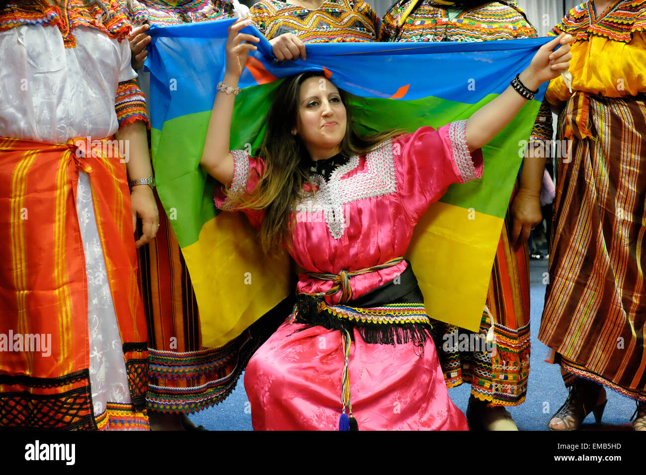 Algerian women in traditional clothes hold an Amazigh flag ...