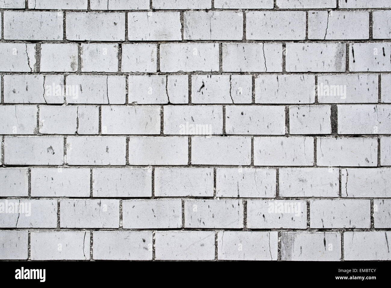 Background Pattern Of Weathered Old White Brick Wall