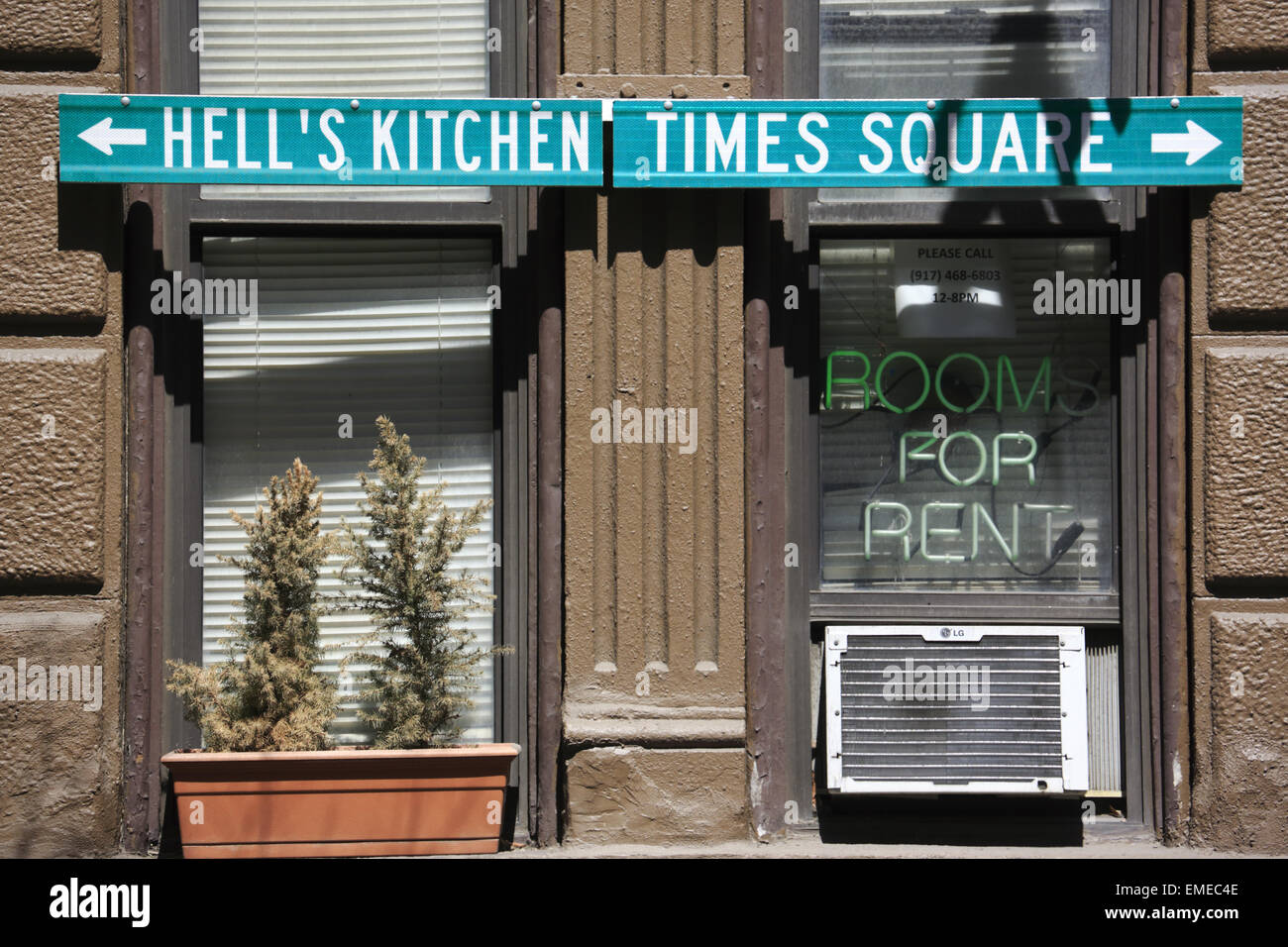 Hell\'s kitchen and Times Square direction signs on a building ...