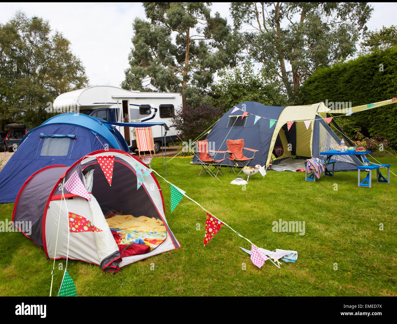C&site With Pitched Tents And C&ervan & Campsite With Pitched Tents And Campervan Stock Photo Royalty ...