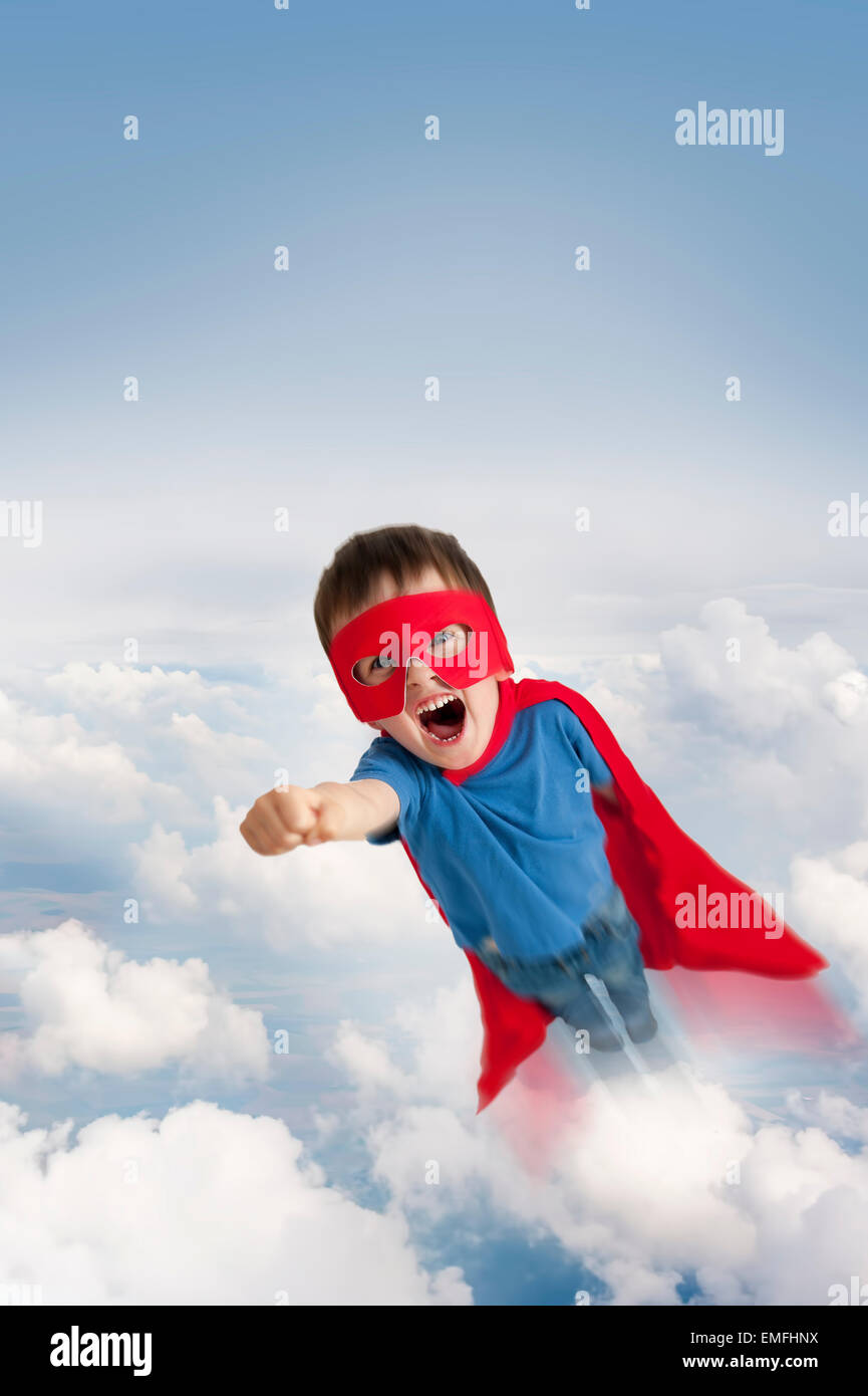 Superhero boy flying in the sky through clouds stock photo 81477814 superhero boy flying in the sky through clouds publicscrutiny Images