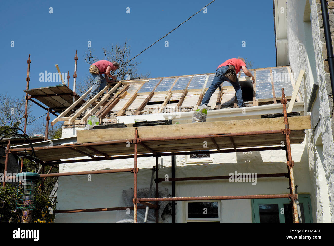 Good Builders ROOFERS Brian White And Jim Hill Putting A New Roof On A Rural  Welsh Stone Cottage House Home In Fabulous Sunshine Weather Llanwrda, ...