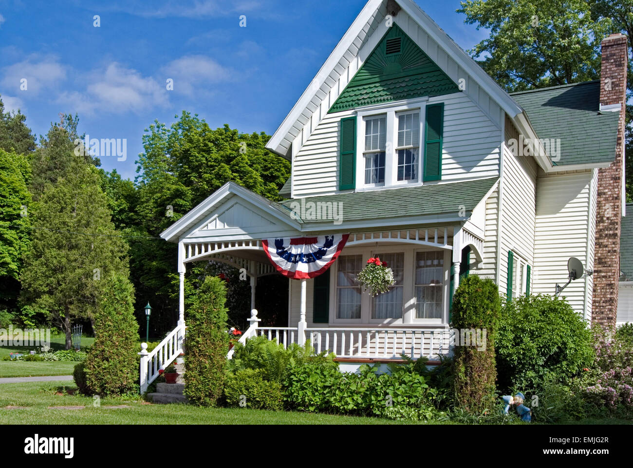 old farmhouse with patriotic american flag bunting in summer stock image