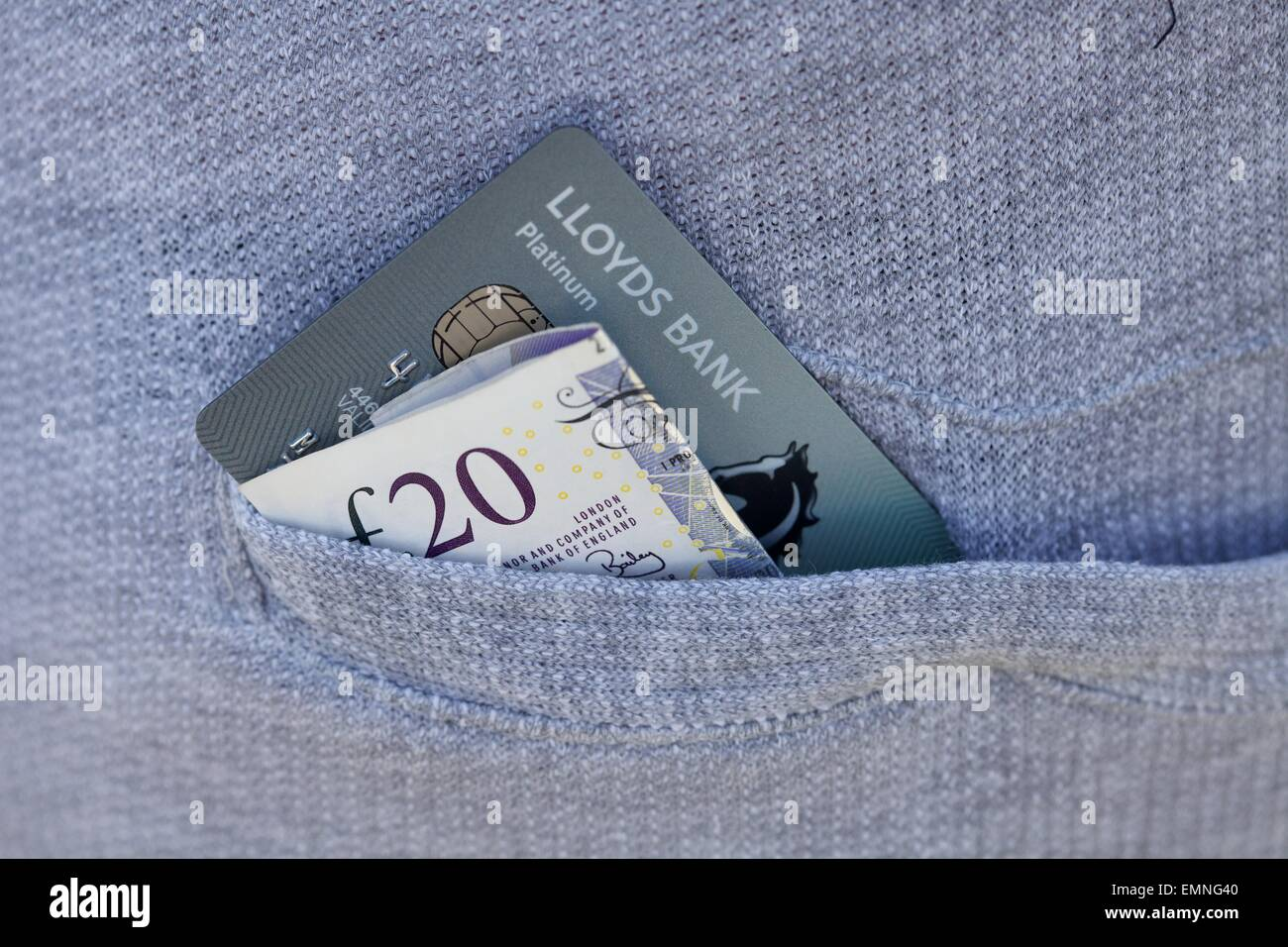 Close Up Shot Of Back Pocket Of Trousers With Lloyds Bank Debit Card And  Money