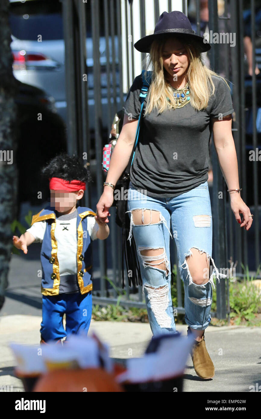Hilary Duff, Mike Comrie, and their son Luca Comrie arrive at ...