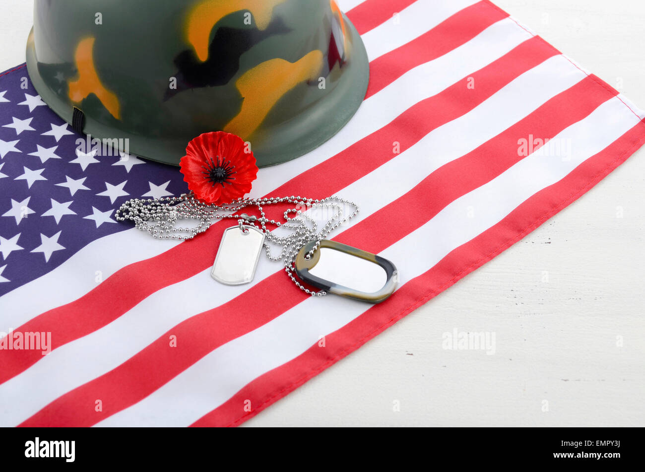 Usa memorial day concept with dog tags and red remembrance poppy usa memorial day concept with dog tags and red remembrance poppy on american stars and stripes flag on white vintage wood table publicscrutiny Image collections