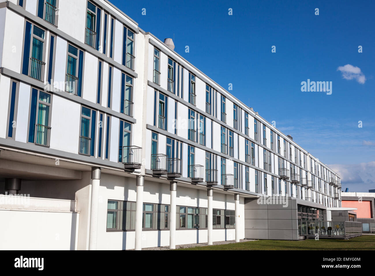 Stock Photo - White building with modern urban architecture
