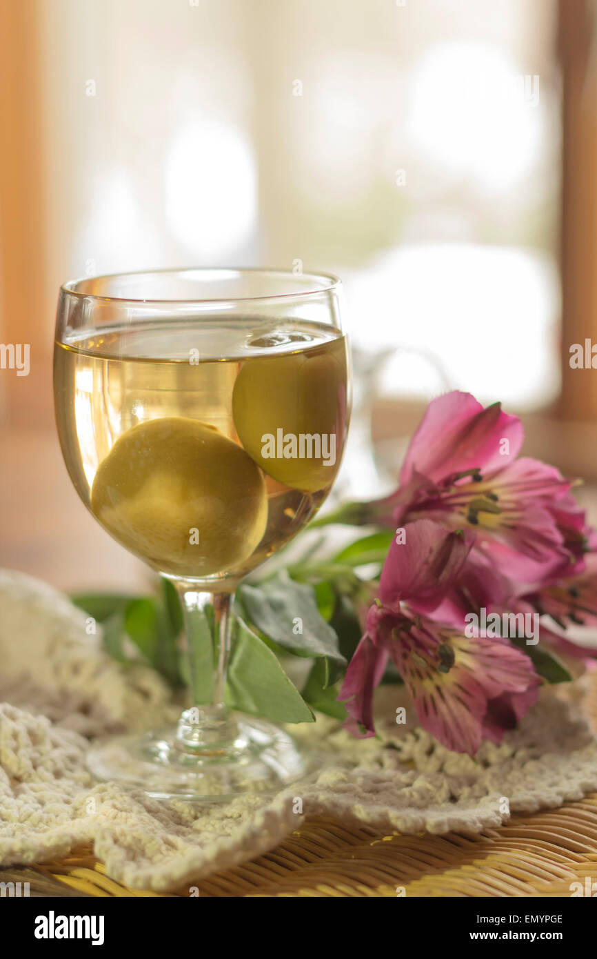 sweet japanese plum wine with fruit in glass photographed. Black Bedroom Furniture Sets. Home Design Ideas