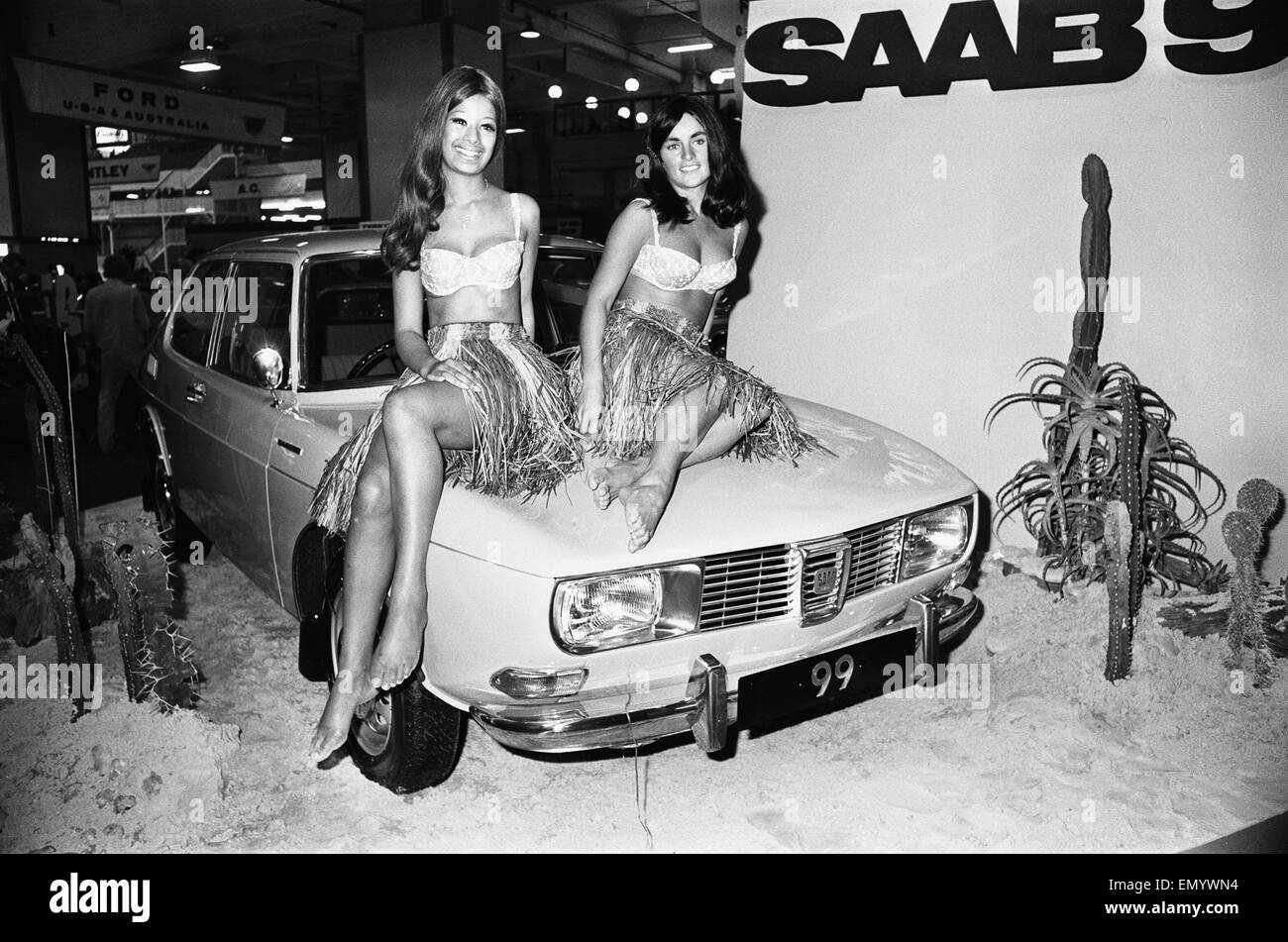Models Drapped Over The Bonnet Of A Saab 99 Motor Car At The 1969