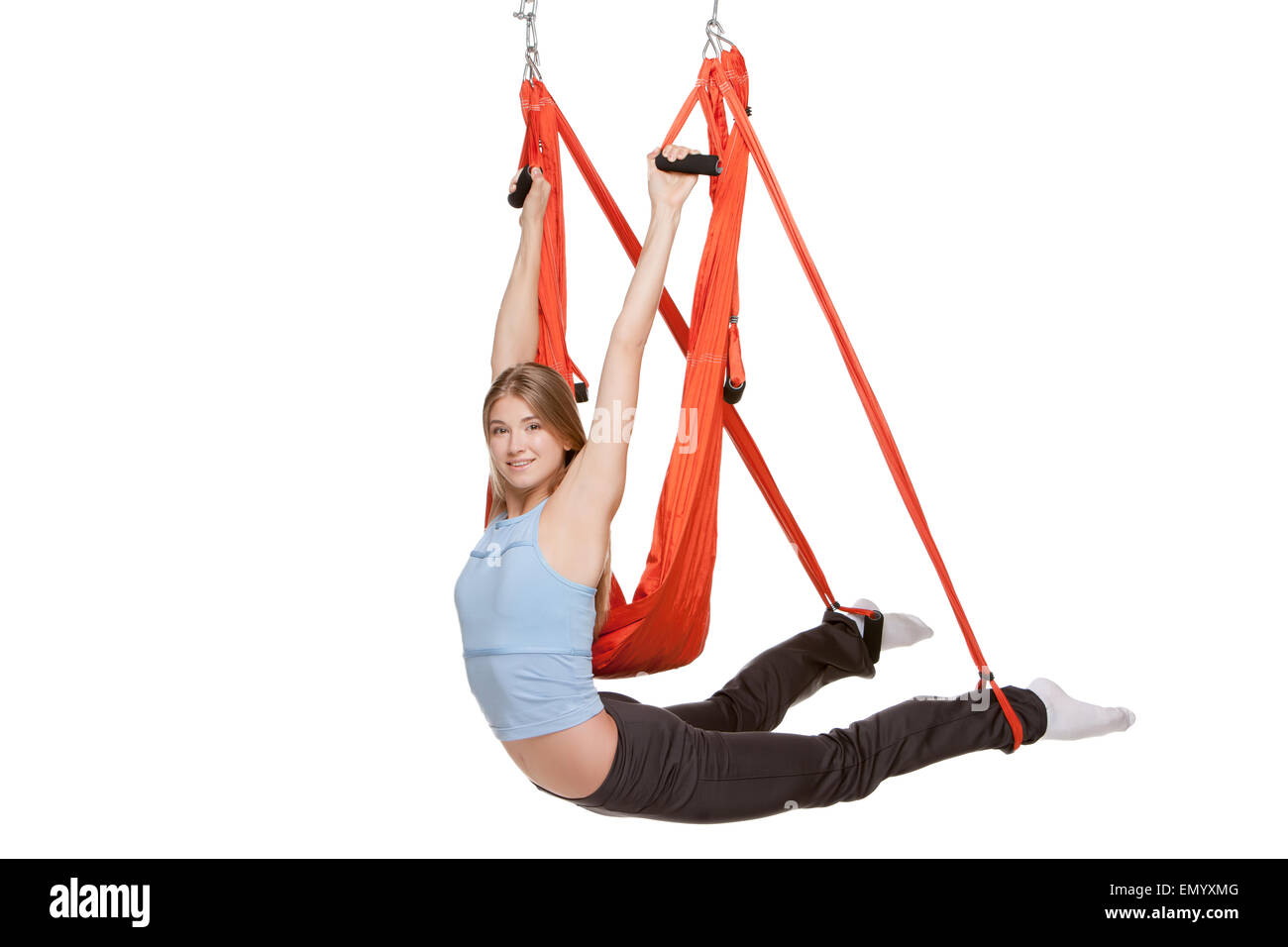 young woman doing anti gravity aerial yoga in red hammock on a seamless white background young woman doing anti gravity aerial yoga in red hammock on a      rh   alamy