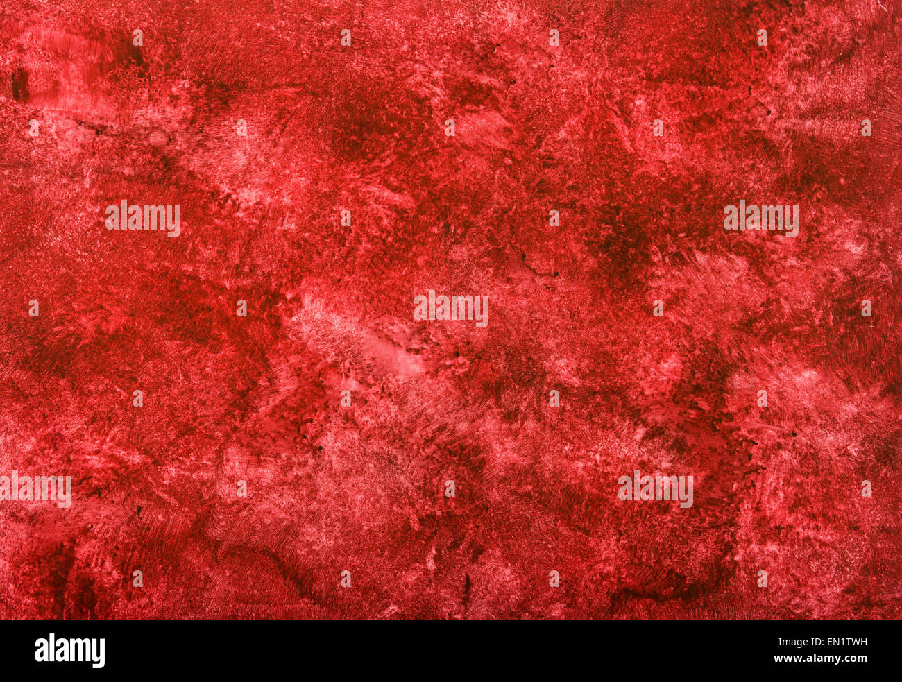 vibrant red marbled paper pattern with blended mottled shades of