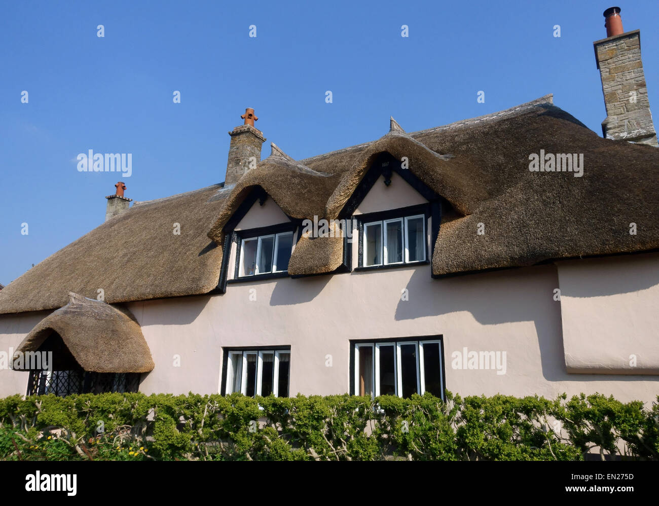 Traditional thatched roof house in village in somerset england stock photo royalty free image - Traditional houses attic ...