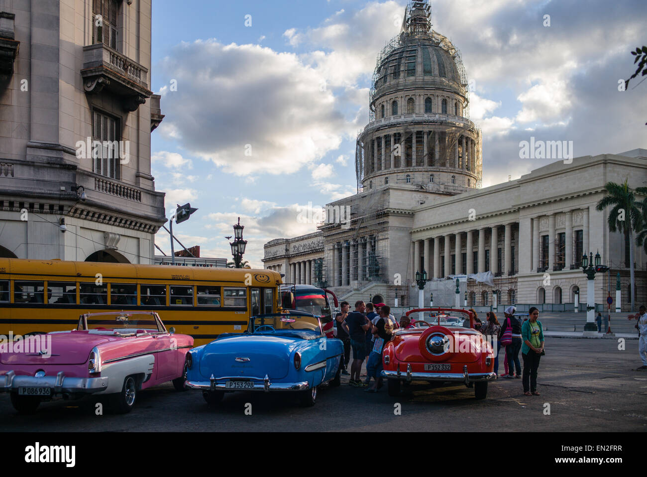 Vintage cars being used as taxis on the street in front of the ...