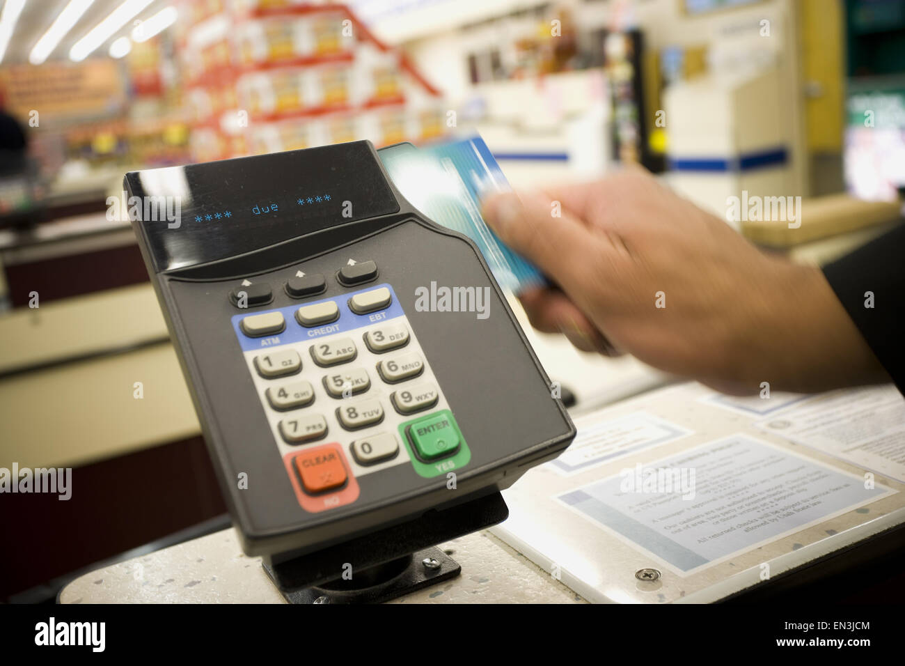 Person swiping debit card at POS machine Stock Photo, Royalty Free ...