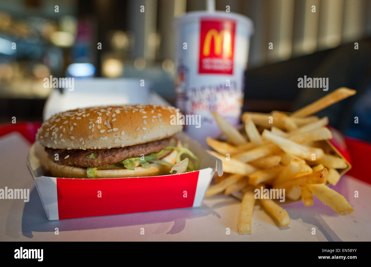 illustration a large portion of french fries a classic big mac burger and a large size coke are on display on a tray at a branch restaurant of fast food - Large Restaurant 2015