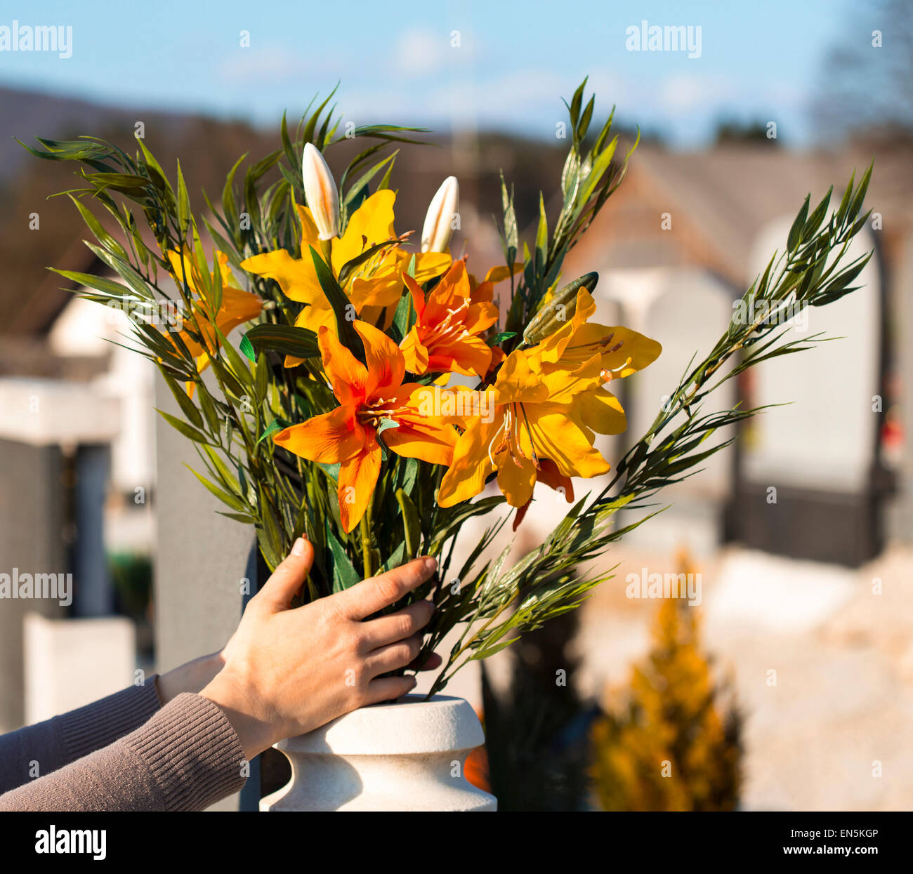 Hand placing flowers in the vase on the graveyard stock photo hand placing flowers in the vase on the graveyard reviewsmspy