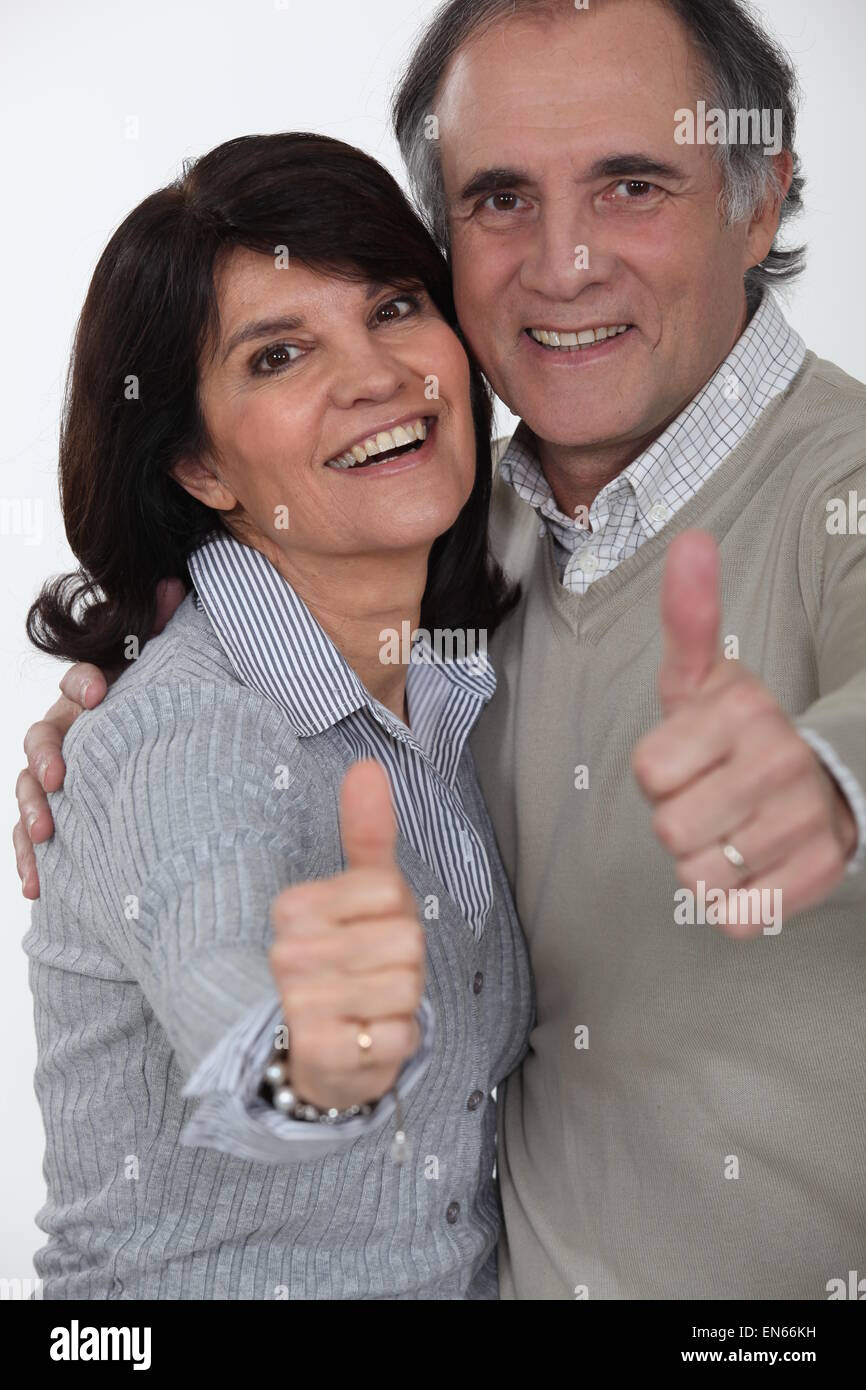 mature couple thumbs up and all smiles stock photo, royalty free
