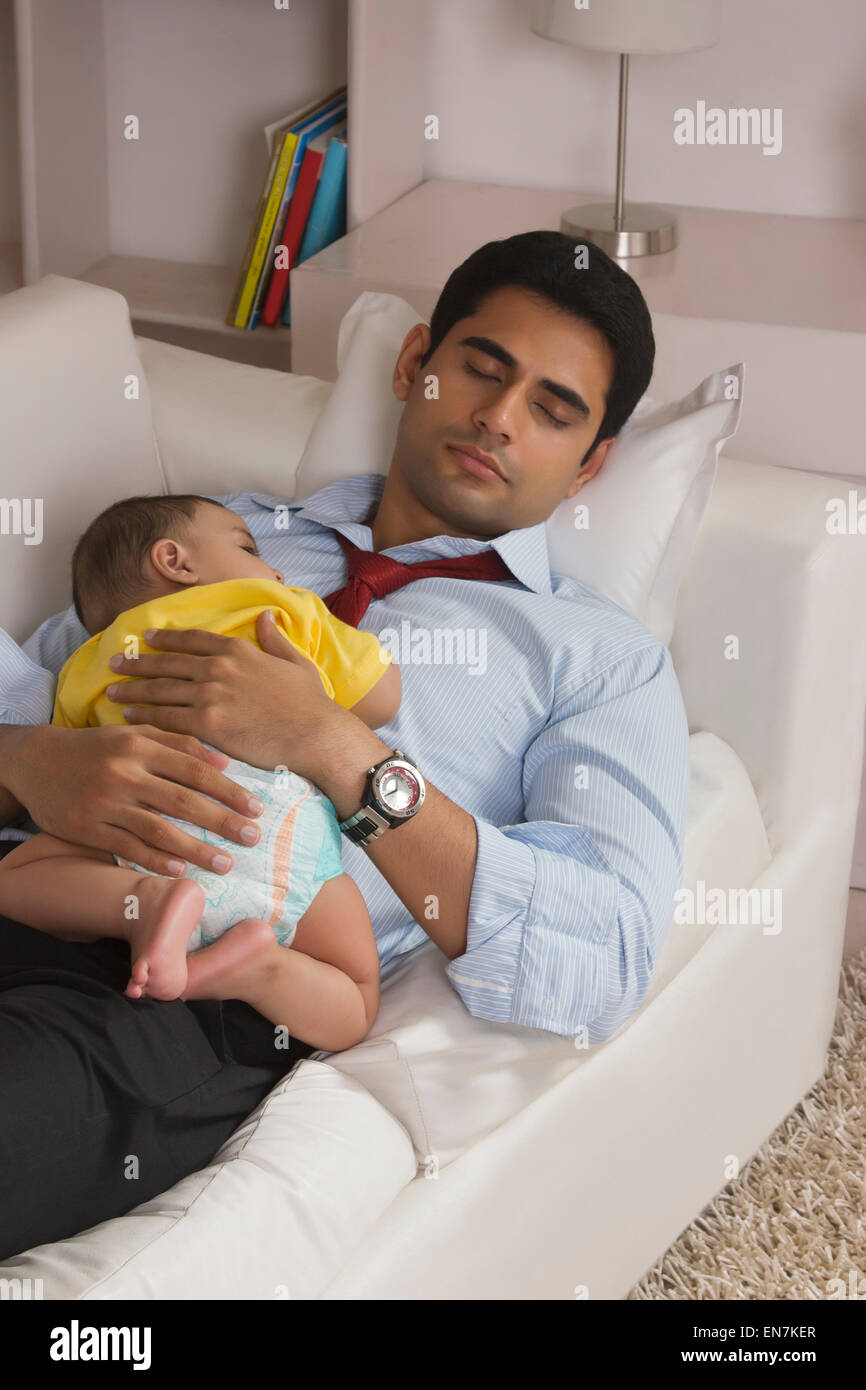 Father And Baby Sleeping On Sofa Stock Photo Royalty Free