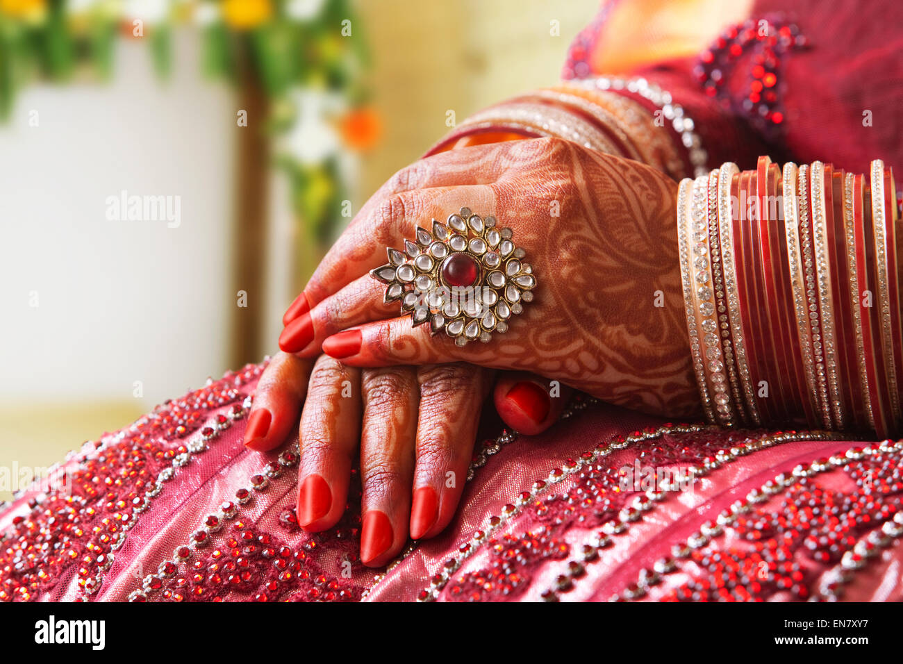 Close-up of a Brides hands in wedding bangles and ring Stock Photo ...