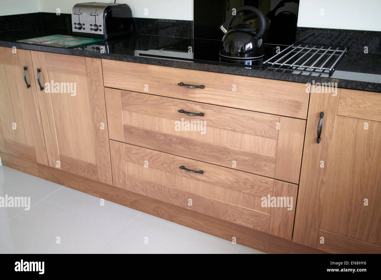 stock photo brand new kitchen cabinets and granite worktops in a new build property in the uk
