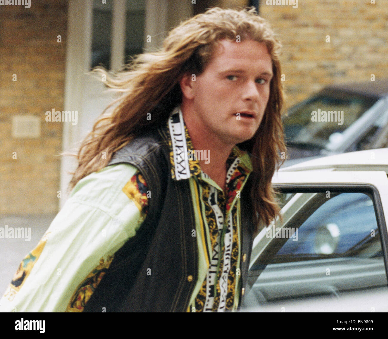 England footballer paul gascoigne walks out of a crimpers salon england footballer paul gascoigne walks out of a crimpers salon showing off his new hair extensions 8th august 1993 pmusecretfo Gallery