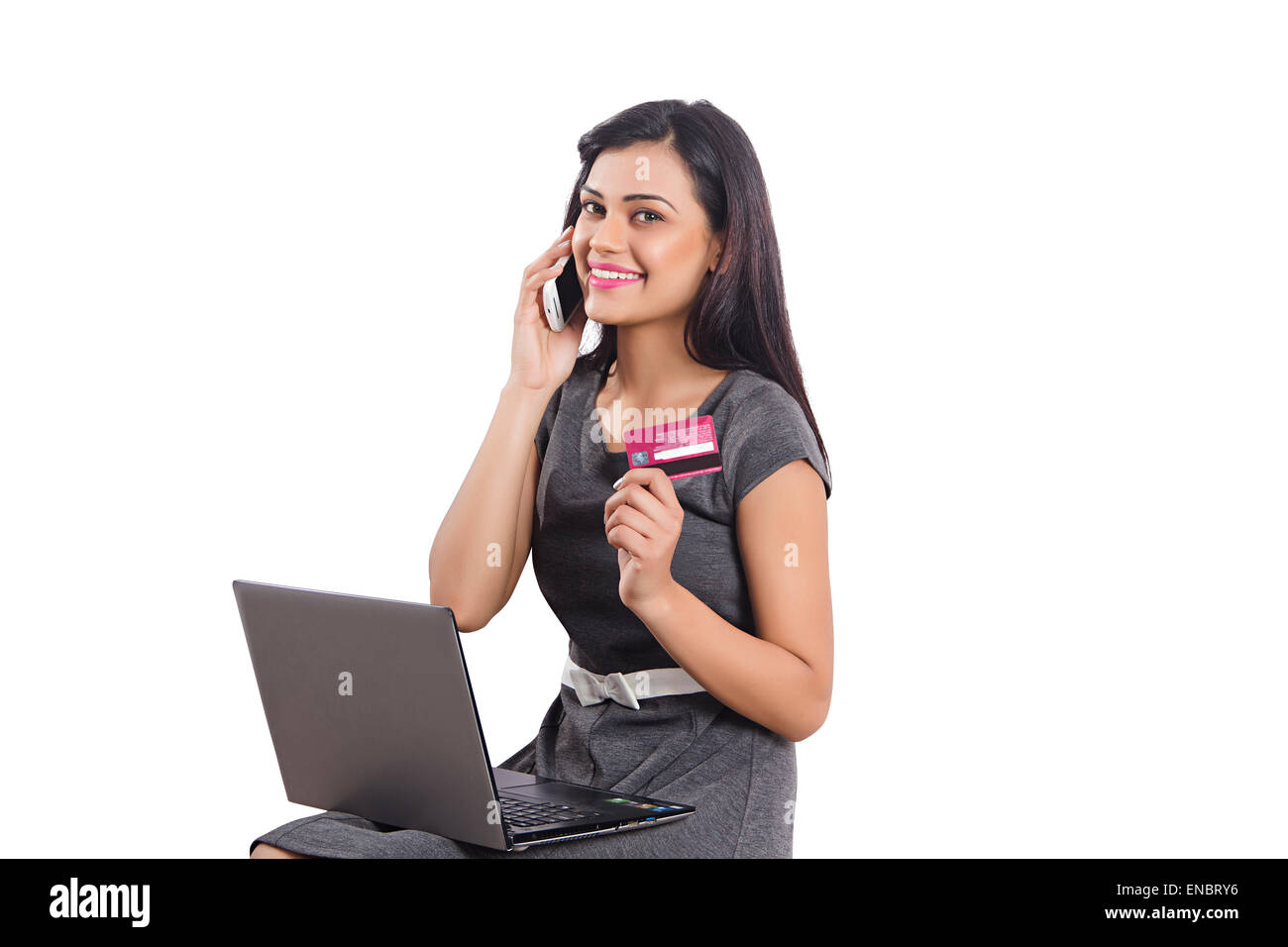 1 indian business woman credit card shoping laptop and talking phone 1 indian business woman credit card shoping laptop and talking phone reheart Images