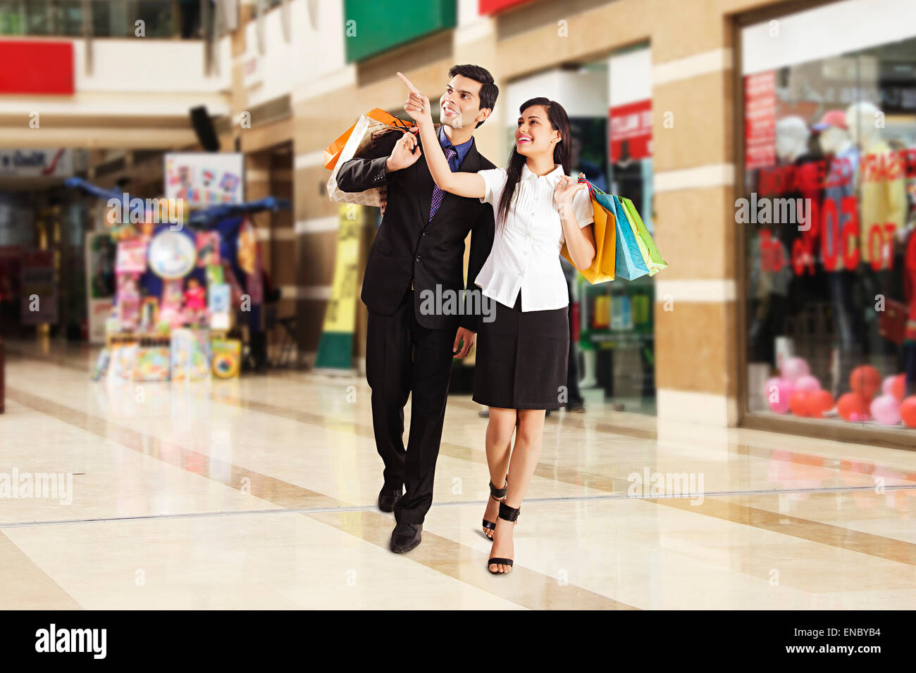 2 Indian Business Couple Mall Shopping Stock Photo
